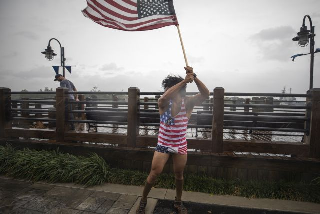 Jeff Egyp marches along the Cape Fear River as Hurricane Florence hits Wilmington, North Carolina USA, 13 September 2018. Hurricane Florence has been downgraded to a category 2 storm on the Saffir-Simpson Hurricane Wind Scale, though is still expected to bring a storm surge with heavy flooding to the Carolinas. EPA/JIM LO SCALZO