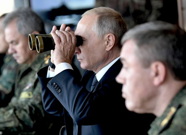 Russian President Vladimir Putin (C), Defense Minister Sergei Shoigu (L) and General of Army Valery Gerasimov (R) attend Russia's biggest ever military maneuvers, Vostok 2018 (East 2018) on the military range Tsogol, Zabaykalsky Kray, Russia, 13 September 2018. The exercises are the biggest since 1981 and will including 297,000 military servicemen, more than 1,000 different military aircrafts, up to 36,000 vehicles, plus 80 warships. Forces from China and Mongolia will take part in the exercises, which will run from 11 to 17 September. EPA/ALEXEY NIKOLSKY / SPUTNIK / POOL MANDATORY CREDIT