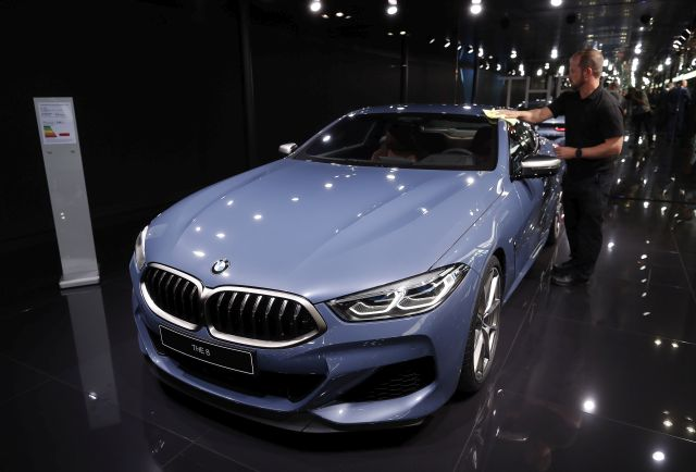 A BMW Serie 3 THE 8 model is polished to be displayed at the stand of the German car maker at the Paris Motor Show 'Mondial de l'Automobile' in Paris, France, 02 October 2018. The Paris Motor Show, which takes place every two years, runs from 04 to 14 October 2018 with international car makers presenting their latest models and studies. EPA/IAN LANGSDON