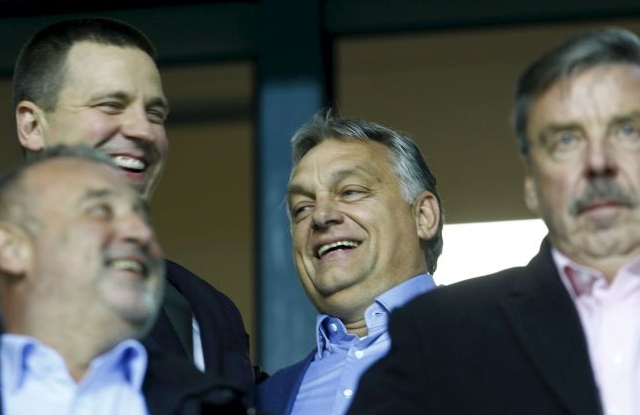 Prime Minister of Estonia Juri Ratas (L) and Prime Minister of Hungary Viktor Orban (C) during the UEFA Nations League soccer match between Estonia and Hungary at the A Le Coq Arena in Tallinn, Estonia, 15 October 2018. EPA/VALDA KALNINA