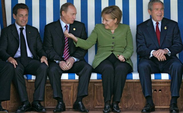 French President Nicolas Sarkozy, Russian President Vladimir Putin, German Chancellor Angela Merkel, U.S. President George W. Bush and British Prime Minister Anthony Blair sit underneath their national flags in a beach chair in Heiligendamm, Germany, 07 June 2007 (reissued 04 December 2018). A successor to Angela Merkel as chairwoman of her CDU party will be elected on 07 December 2018. Merkel said she will not run for re-election as CDU chairwoman nor for Chancellor nor for any other political office. EPA/DMITRY ASTAKHOV