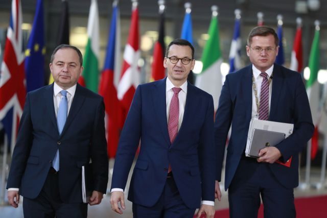 Poland's Prime Minister Mateusz Morawiecki (C) arrives with Polish Minister for European Affairs Konrad Szymanski (R) at the European Council in Brussels, Belgium, 13 December 2018. EPA/STEPHANIE LECOCQ