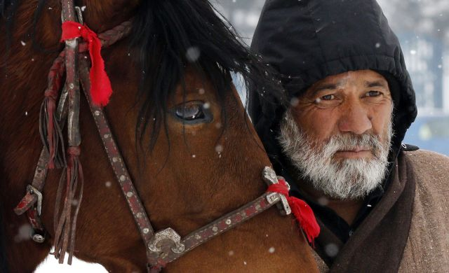epaselect epa07273220 An Afghan horseman waits for customers to ride his horse for one US Dollar per ride during a snowy day on a hilltop in Kabul, Afghanistan, 10 January 2019. Afghanistan in most of its northern provinces has about seven months of harsh winter which decreases the job opportunities for the Afghan workers as most of the projects shuts down. EPA/JAWAD JALALI