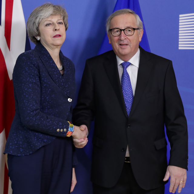 British Prime Minister Theresa May (L) is welcomed by European commission President Jean-Claude Juncker (R) ahead to a meeting on Brexit in Brussels, Belgium, 07 February 2019. May is in Brussels to discuss Brexit and related issues. EPA/STEPHANIE LECOCQ