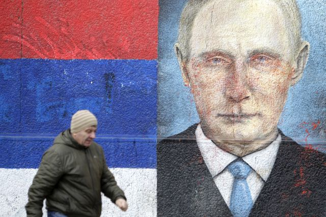 A man walks past a mural depicting Russian President Vladimir Putin in Belgrade, Serbia, 15 January 2019. Putin is expected to visit the Serbian capital Belgrade on 17 January 2019. EPA/ANDREJ CUKIC