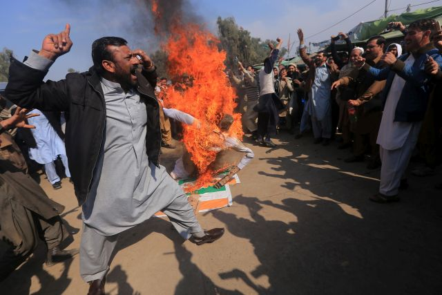 People burn an effigy of Indian Prime Minister Narendra Modi, as they celebrate a day after Pakistani shot Indian fighter jets, during an anti-India protest in Peshawar, Pakistan, 28 February 2019. Pakistan's Prime Minister Imran Khan on 27 February, offered talks to India amid escalating military tension after the two countries claimed to have shot down each other's fighter planes in cross-border aerial strikes in disputed Kashmir region. reiterated his offer to carry out an investigation into an attack in India-administered Kashmir on 14 February that killed 42 Indian paramilitary troopers and which is at the heart of the latest spike in military and diplomatic tension between India and Pakistan. EPA/BILAWAL ARBAB