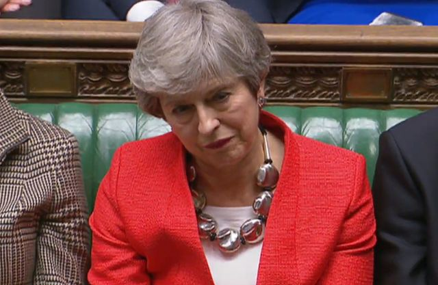 A grab from a handout video made available by the UK Parliamentary Recording Unit shows British Prime Minister Theresa May in the House of Commons parliament in London, Britain, 12 March 2019. MPs defeated her Brexit deal by 149 votes. The United Kingdom is officially due to leave the European Union on 29 March 2019, two years after triggering Article 50 in consequence to a referendum. EPA/UK