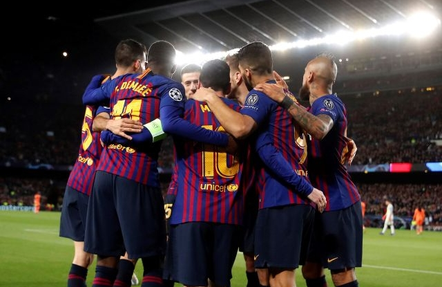 FC Barcelona players celebrate the third goal against Olympique Lyon during the UEFA Champions League round of 16 second leg soccer match between FC Barcelona and Olympique Lyon at Camp Nou in Barcelona, Catalonia, north eastern Spain, 13 March 2019. EPA/ALBERTO ESTEVEZ