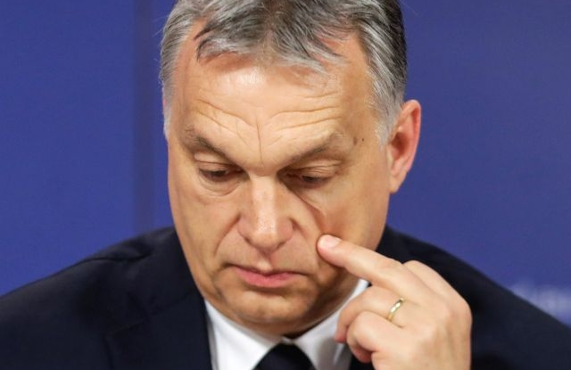 Hungarian Prime Minister Viktor Orban scatches his cheek as he attends a press conference at the end of the European People's Party (EPP) Political Assembly at the European Parliament in Brussels, Belgium, 20 March 2019. The Fidesz party of Orban has been temporary suspended by EPP. EPA/STEPHANIE LECOCQ