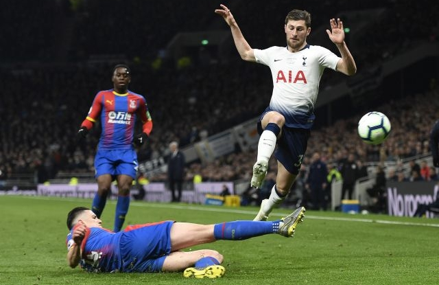 Tottenham's Ben Davies (R) vies for the ball against Crystal Palace's Martin Kelly (L) during the English Premier League soccer match between Tottenham Hotspur and Crystal Palace at the Tottenham Hotspur Stadium in London, Britain, 03 April 2019. EPA/WILL OLIVER