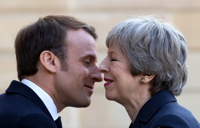 French President Emmanuel Macron (L) greets British Prime Minister Theresa May (R) as she arrives for a meeting at the Elysee Palace in Paris, France, 09 April 2019. British Prime Minister Theresa May is in Paris and Berlin seeking an extension to article 50. EPA/IAN LANGSDON