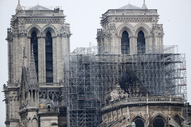 A view of the scaffolding after a massive fire destroyed the roof of the Notre-Dame Cathedral in Paris, France, 16 April 2019. A fire started in the late afternoon on 15 April in one of the most visited monuments of the French capital. EPA/IAN LANGSDON