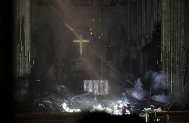 General view of the interior of the Notre-Dame Cathedral as flames are burning the roof cathedral in Paris, France, late 15 April 2019. A fire started in the late afternoon in one of the most visited monuments of the French capital. EPA/YOAN VALAT