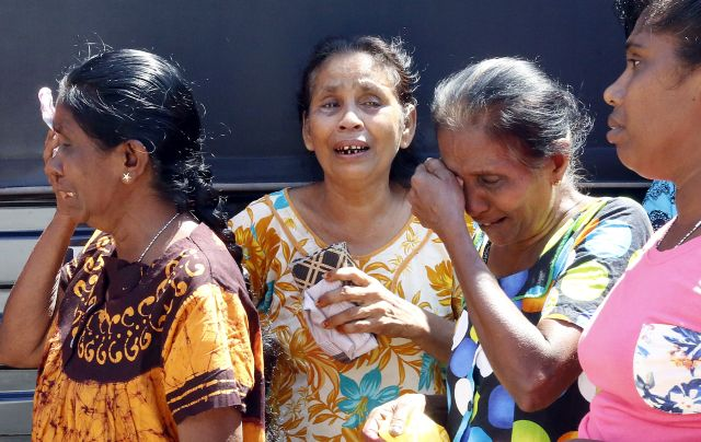 Grieving relatives wait to receive the bodies of family members, who were victims to a series of blasts in Colombo, Sri Lanka, 22 April 2019. According to news reports, at least 290 people have been killed and over 500 were injured on 21 April 2019 in a series of blasts during Easter Sunday service at churches and at hotels across Colombo. EPA/M.A. PUSHPA KUMARA