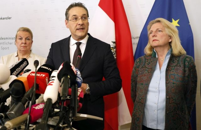 Austria's Vice-Chancellor Heinz Christian Strache (C) of the Austrian Freedom Party (FPOe) gives a statement to the journalists as Labour Minister Beate Hartinger-Klein (L) and Foreign Minister Karin Kneissl (R) listen in the Ministry of Public Service and Sport in Vienna, Austria, 18 May 2019. Austrian Vice Chancellor Strache on 18 May 2019 said he will step down from his post as media caught the far-right FPOe's leader Strache in a corruption allegations scandal. German media have on 17 May 2019 published a secretly recorded video of Strache in Ibiza in July 2017, where Heinz-Christian Strache is claimed to meet an alleged niece of a unknown Russian oligarch who wanted to invest large sums of money in Austria. EPA/FLORIAN WIESER