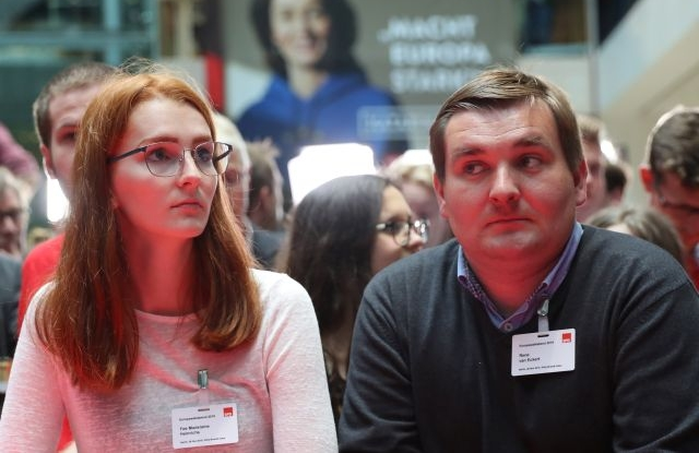 Supporters of the Social Democratic Party (SPD) react to the publication of the first exit polls prognosis of the European elections at the SPD headquarters Willy-Brandt-Haus in Berlin, Germany, 26 May 2019. The European Parliament election was held by member countries of the European Union (EU) from 23 to 26 May 2019. EPA/HAYOUNG JEON