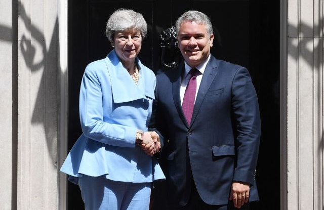 British Prime Minister Theresa May (L) welcomes President of Colombia Ivan Duque Marquez (R) to 10 Downing Street in London, Britain 17 June, 2019. Colombian President Ivan Duque is currently in Europe visiting Britain and France. EPA/ANDY RAIN