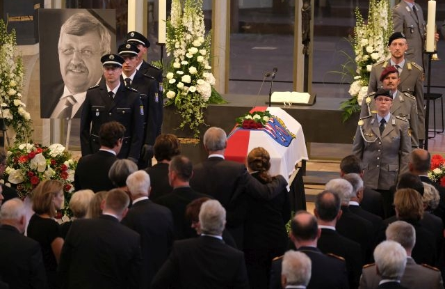 Family members pay their last respects at the coffin of murdered German politician Walter Luebcke at the conclusion of his memorial service at St. Martin church in Kassel, Germany, 13 June 2019. Luebcke was found dead, shot in the head at close range, on the terrace of his home on 02 June. Investigators have ruled out suicide and are investigating the case as murder. Luebcke, a Christian Democrat (CDU), was outspoken in his pro-immigration views, and one possibility investigators are pursuing is a right-wing motive to the shooting. EPA/SEAN GALLUP / POOL
