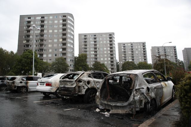 Burned out cars at Frolunda Square in Gothenburg, Sweden, 14 August 2018. EPA: ADAM IHSE