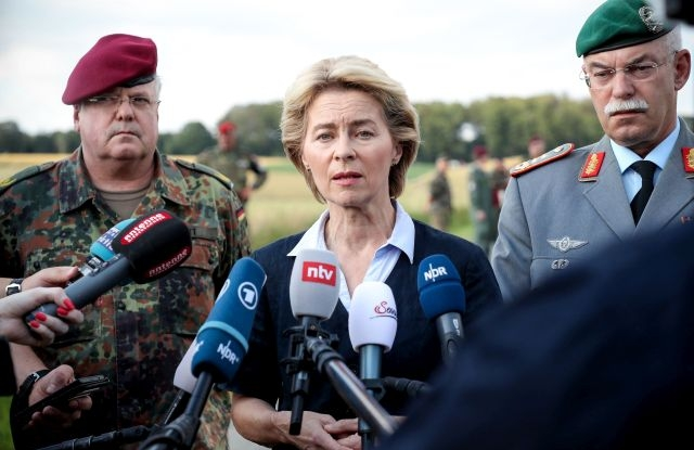 German Defense Minister Ursula von der Leyen (C) gives a media statement during a visit at the crash site of a helicopter near the village Aerzen Dehmke in the area of Hameln-Pyrmont, Germany, 01 July 2019. According to the police, a helicopter from the Bueckeburg Army Aviation crashed in the German federal state of Lower Saxony during a low-flying training flight. One pilot is reported to be dead, another one is seriously injured. The helicopter is said to be fully burnt out. EPA/FRIEDEMANN VOGEL