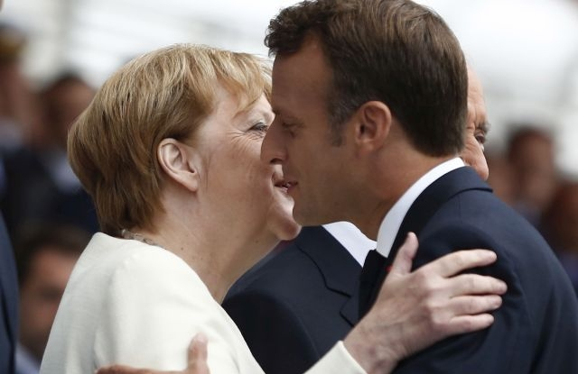 French President Emmanuel Macron hugs German Chancellor Angela Merkel during Bastille Day parade on the Champs Elysees avenue in Paris, France, 14 July 2019. EPA/Kamil Zihnioglu / POOL MAXPPP OUT