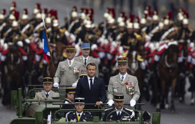 French President Emmanuel Macron (C) on board the command car, flanked by mounted Repulblican Guard, attends the annual Bastille Day military parade on the Champs Elysees avenue in Paris, France, 14 July 2019. Bastille Day, the French National Day, is held annually on 14 July to commemorate the storming of the Bastille fortress in 1789. EPA/IAN LANGSDON