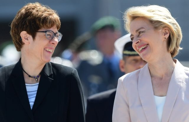 Outgoing German Defense Minister and newly elected European Commission President Ursula von der Leyen (R) and designated German Defense Minister Annegret Kramp-Karrenbauer during a inauguration ceremony with military honors at the Defense Ministry in Berlin, Germany, 17 July 2019. Outgoing German Defense Minister Ursula von der Leyen was elected as European Commission President on 16 July. She will be succeeded by Annegret Kramp-Karrenbauer. EPA/CLEMENS BILAN