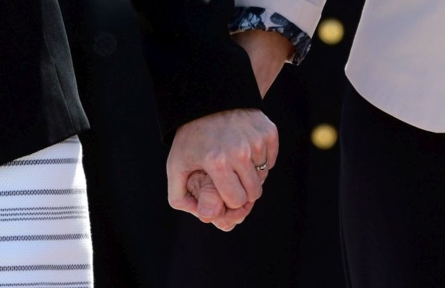 Outgoing German Defense Minister and newly elected European Commission President Ursula von der Leyen (R) and designated German Defense Minister Annegret Kramp-Karrenbauer hold hands during an inauguration ceremony with military honors at the Defense Ministry in Berlin, Germany, 17 July 2019. Outgoing German Defense Minister Ursula von der Leyen was elected as European Commission President on 16 July. She will be succeeded by Annegret Kramp-Karrenbauer. EPA/CLEMENS BILAN