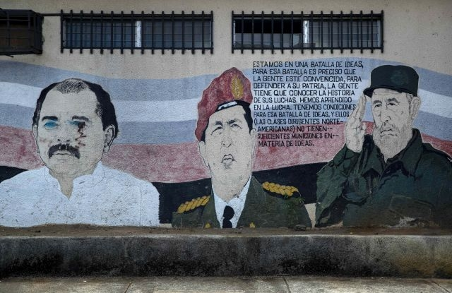A mural picturing (L-R) Nicaraguan President, Daniel Ortega, late Venezuelan President, Hugo Chavez, and late Cuban leader Fidel Castro seen in Managua, Nicaragua, 17 July 2019 (issued 18 July 2019). The Sandinista Revolution will celebrate its 40th anniversary on 19 July 2019 amid protests against Daniel Ortega's government. Ortega was one of the leaders of the revolutionary Sandinista National Libveration Front. Nicaragua has been gripped by a crisis since street protests against social security reforms broke out in April 2018. EPA/Jorge Torres