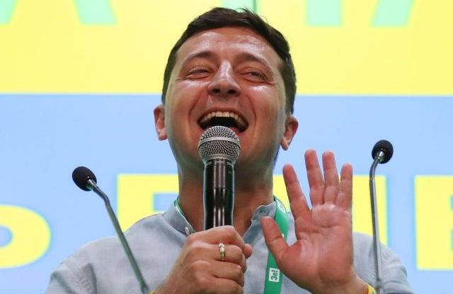 Ukraine's President Volodymyr Zelensky speaks to media at his party's headquarters after the parliamentary elections in Kiev, Ukraine, 21 July 2019. According to exit polls, President's Zelenskiy Servant of the People party won the elections and will have majority in parliament. Ukrainians voted in extraordinary parliament's elections after President Volodymyr Zelensky dissolved parliament during his inauguration on 21 May 2019. EPA/TATYANA ZENKOVICH