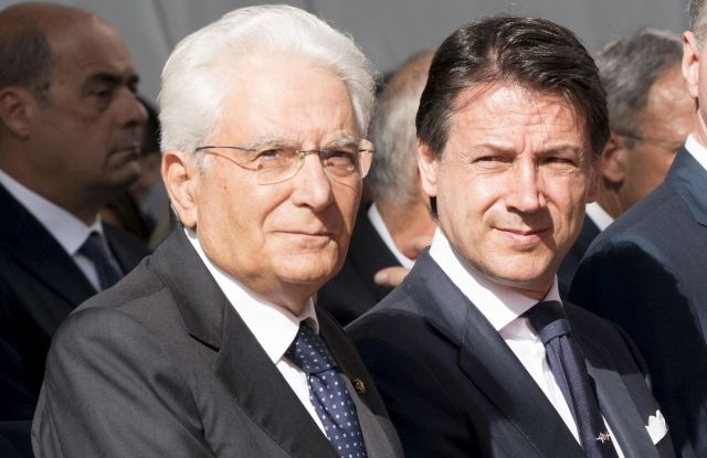 A handout photo made available by the Chigi Palace Press Office shows Italian Prime Minister Giuseppe Conte (R) and Italian President Sergio Mattarella (L) attending a memorial ceremony for the victims on the first anniversary of the Morandi highway bridge collapse, in Genoa, northern Italy, 14 August 2019. The motorway bridge partially collapsed on 14 August 2018, killing 43 people.