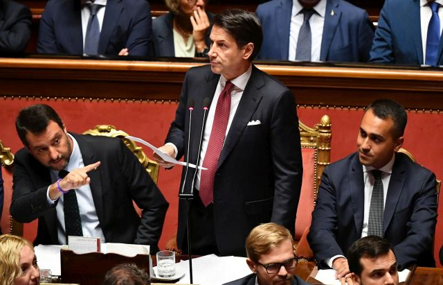 Italian Prime Minister Giuseppe Conte (C) is flanked by Deputy Prime Ministers Matteo Salvini (L) and Luigi Di Maio (R) as he addresses the Senate as he addresses the Senate in Rome, Italy, 20 August 2019. Conte in his address to the senate called bringing about the government crisis irresponsible. Deputy Premier and Interior Minister Matteo Salvini and his party League pulled out from government and caused a political crisis a week ago. Conte said that the government has come to an end and that he would resign. EPA/ETTORE FERRARI