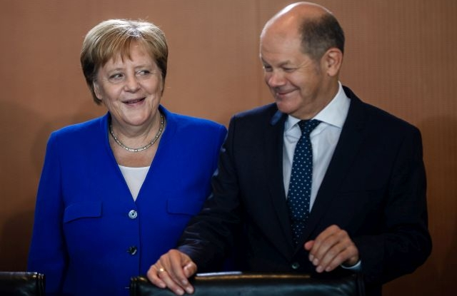 German Chancellor Angela Merkel (L) and German Minister of Finance Olaf Scholz (R), during the beginning of a cabinet meeting at the Chancellery in Berlin, Germany, 21 August 2019. The cabinet of the German government meets on a regular basis. EPA/CLEMENS BILAN