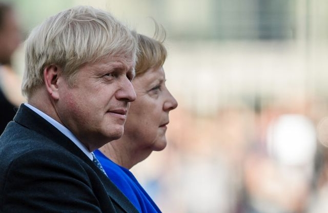 German Chancellor Angela Merkel (R) and British Prime Minister Boris Johnson sit next to each other during a ceremony with military honors at the Chancellery in Berlin, Germany, 21 August 2019. Prior to the G7 summit in Biarritz form 24 to 27 August 2019, Johnson meets Angela Merkel and on the next day French President Emmanuel Macron. In the talks, Johnson is expected to try to resume the Brexit talks, so that it will not come to a 'no deal' exit of the United Kingdom from the EU on 31 October 2019. EPA/CLEMENS BILAN