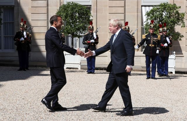 French President Emmanuel Macron (L) greets British Prime Minister Boris Johnson (R) as he arrives for a meeting at the Elysee Palace in Paris, France, 22 August 2019. Johnson is in Paris after a one day visit in Berlin. EPA/CHRISTOPHE PETIT TESSON