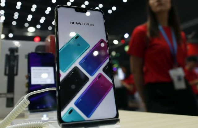 A Huawei smartphone is displayed next to a salesperson at the Thailand Mobile Expo 2019 in Bangkok, Thailand, 30 May 2019 (reissued 09 August 2019) Reports on 09 August 2019 state Huawei has presented their new smartphone operating system, called Harmony OS, at the at the annual developers' conference of Huawei in Dongguan, China. Huawei said it would be able to replace current operating system Android at a short notice should the US block the company from using it. EPA/RUNGROJ YONGRIT