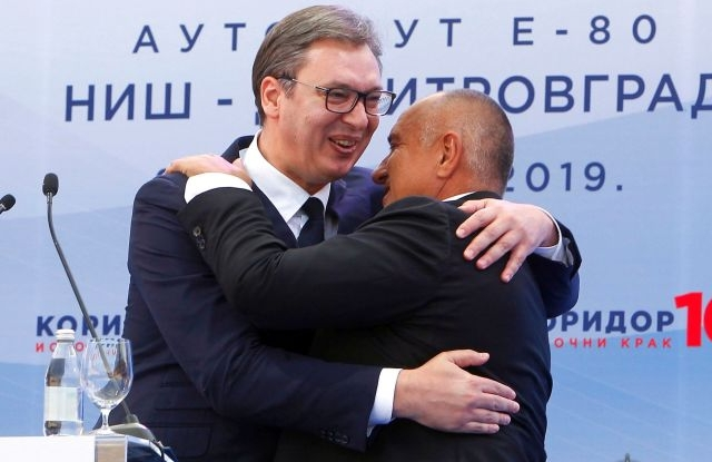 Serbian President Aleksandar Vucic (L) and Bulgarian Prime Minister Boyko Borisov (R) embrace each other on podium as they attend the opening ceremony of the Highway Nis - Sofia near Nis in Serbia, 09 November 2019. The new highway connects the cities of Sofia in Bulgaria and Nis in Serbia. EPA/DJORDJE SAVIC