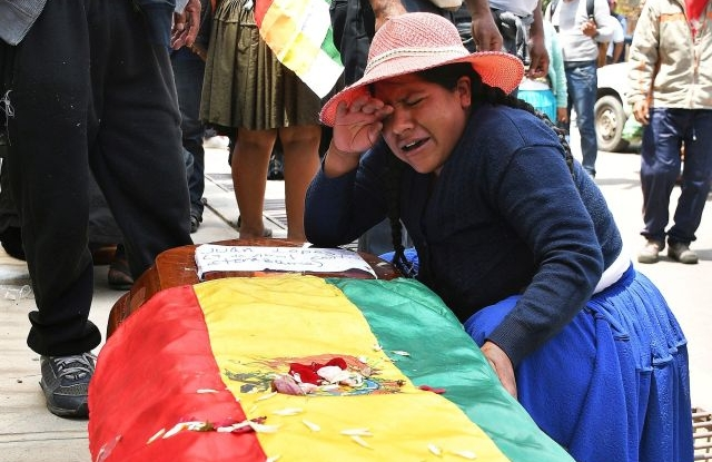 A woman weeps over the coffin of one of those who died in the riots with the police in Cochabamba, Bolivia, 16 November 2019. The number of dead has risen to seven and more than a hundred have been wounded in the clashes between demonstrators and police near the Bolivian city of Sacaba. The clashes took place 15 November on a highway between the cities of Cochabamba and Sacaba. EPA/JORGE ABREGO