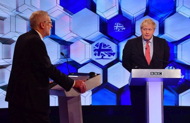 A handout photo made available by the BBC shows Conservative party leader and British Prime Minister Boris Johnson (R) and opposition Labour party leader Jeremy Corbyn (L) during a BBC TV debate in Maidstone, Kent, Britain, 06 December 2019. Britons will go to the polls on 12 December 2019 in a general election. EPA/JEFF OVERS / BBC / HANDOUT MANDATORY CREDIT NOTE TO EDITORS: Not for use more than 21 days after issue. HANDOUT EDITORIAL USE ONLY/NO SALES