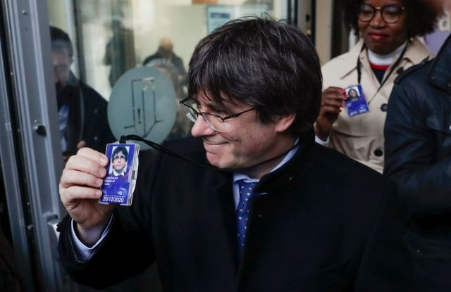 Former Catalan leader Carles Puigdemont (L) departs from the accreditation center of the European Parliament after the decision of the European Court of Justice in Brussels, Belgium, 20 December 2019. The European Court of Justice has ruled on 19 December that Catalan separatist leader Oriol Junqueras has an MEP immunity when he was jailed by the Spanish Supreme Court in October, prompting calls for his immediate release. EPA/STEPHANIE LECOCQ