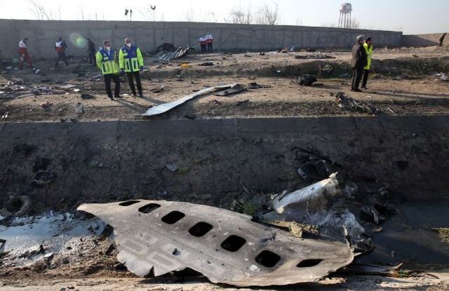 Officials stand near the wreckage after an Ukraine International Airlines Boeing 737-800 carrying 176 people crashed near Imam Khomeini Airport in Tehran, killing everyone on board; in Shahriar, Iran, 08 January 2020. EPA/ABEDIN TAHERKENAREH