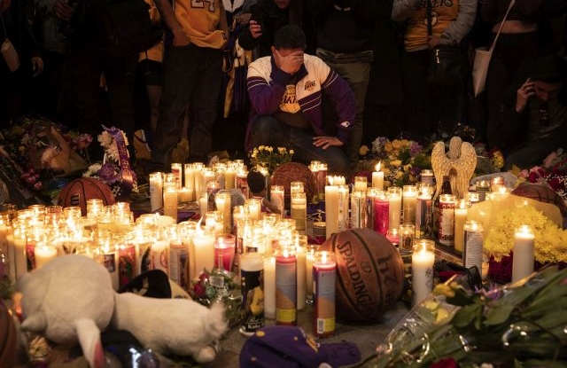 Fans of late Los Angeles Lakers guard Kobe Bryant gather at a memorial at the LA Live entertainment complex across the street from the Staples Center, home of the Los Angeles Lakers, in Los Angeles, California, USA, 26 January 2020. According to media reports, former NBA basketball player Kobe Bryant died in a helicopter crash in Calabasas, California, USA on 26 January 2020. He was 41. EPA/ETIENNE LAURENT