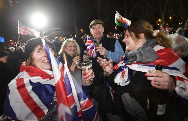 Pro Brexit supporters celebrate after the UK leaves the EU outside the Houses of Parliament in London, Britain, 31 January 2020. Britain officially exited the EU on 31 January 2020, beginning an eleven month transition period. EPA/NEIL HALL