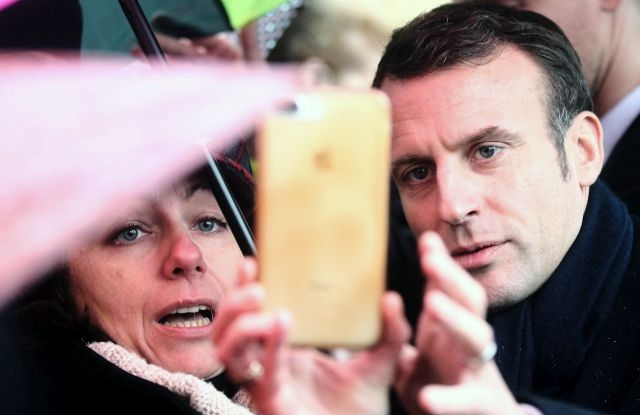 French President Emmanuel Macron (R) poses for a selfie picture with a supporter as he visits the Wawel Royal Castle in Krakow, Poland, 04 February 2020. President Macron is on a two-day official visit to Poland. EPA/LUKASZ GAGULSKI POLAND OUT